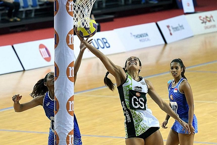 Cook Islands' Alanna Smith going up for a shot as Singapore's Sindhu Nair tries to block her in their Nations Cup match last week. Singapore won 59-47.