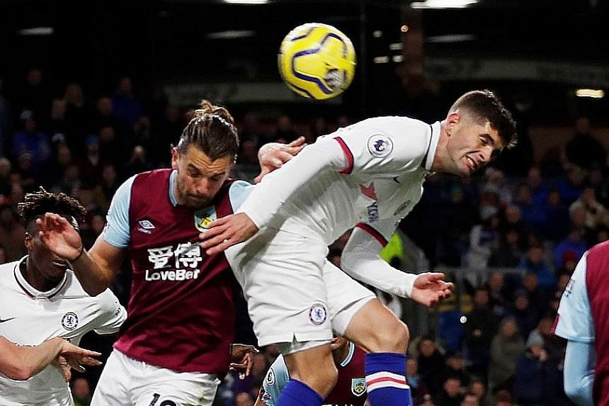 """Chelsea's Christian Pulisic scoring the """"perfect hat-trick"""" in his side's 4-2 win over Burnely in Saturday's Premier League match. He grabbed the opener with his left foot, collected his second with the other foot and used the back of his head (above) to"""