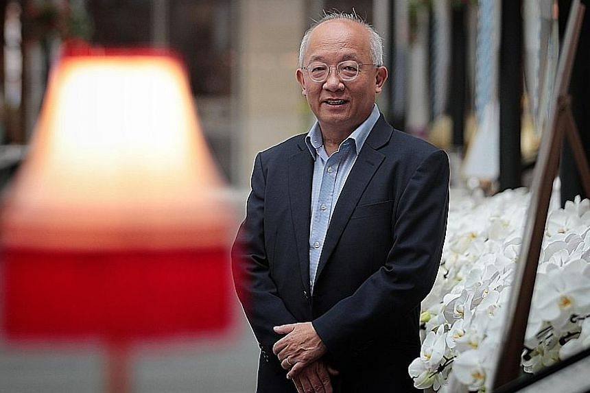 Perennial Real Estate Holdings chief executive Pua Seck Guan said the company's earnings results are likely to improve from next year. ST PHOTO: JASON QUAH