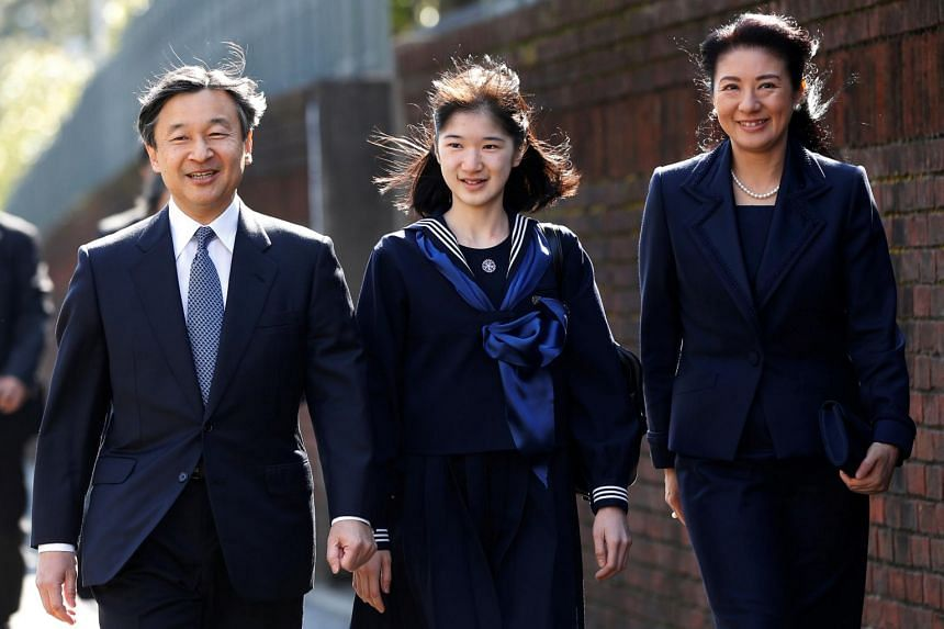 A photo from March 22, 2017 shows Japan's Princess Aiko (centre) accompanied by her parents Emperor Naruhito and Empress Masako in Tokyo, Japan.