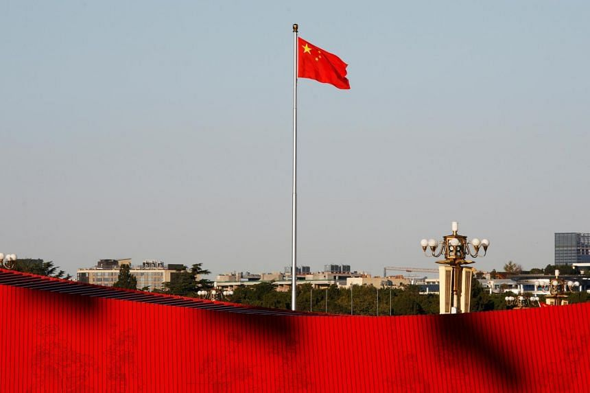 A Chinese flag flutters at the Tiananmen Square in Beijing, on Oct 25, 2019.