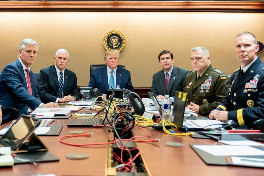 US President Donald Trump, US Vice President Mike Pence (second from left), US Secretary of Defense Mark Esper (third from right), along with members of the national security team, watch as US Special Operations forces close in on ISIS leader Abu Bak
