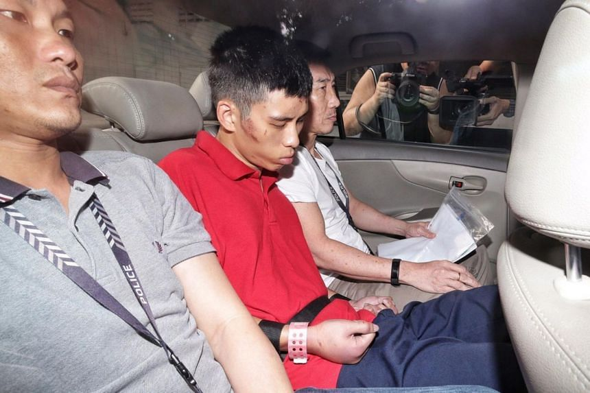 Gabriel Lien Goh, seen with injuries on his face and swelling on his fists and knuckles, arriving at the State Courts on Oct 28, 2019. He was arrested on Sunday evening in Commonwealth over the deaths of two women aged 56 and 90, both related to him.