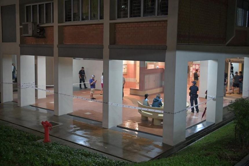 Some residents and police officers seen at the void deck of Blk 7A Commonwealth Ave on Oct 27, 2019.