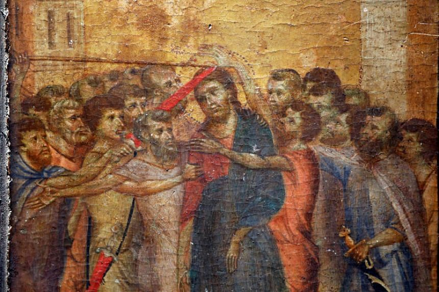 "A part of the painting ""Christ Mocked"", a long-lost masterpiece by Florentine Renaissance artist Cimabue in the late 13th century, which was found months ago hanging in an elderly woman's kitchen in the town of Compiegne, is seen in Paris, France on"