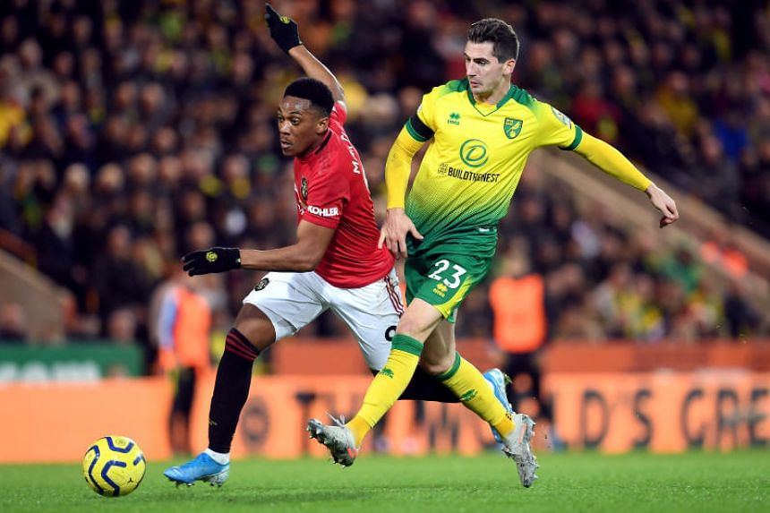 Manchester United's Anthony Martial (left) and Norwich City's Kenny McLean battle for the ball during the English Premier League soccer match between Norwich City and Manchester United at Carrow Road on Oct 27, 2019.