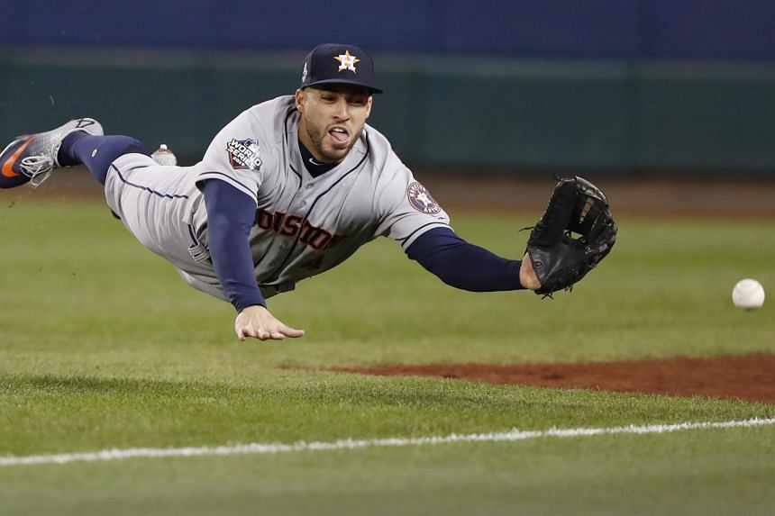 Houston Astros right fielder George Springer dives for a foul ball off the bat at Washington Nationals, on Oct 26, 2019.