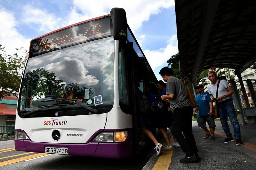 Commuters boarding a bus outside Braddell MRT station.