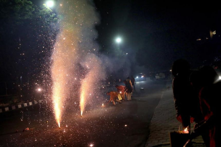 Firecrackers and rockets lit up the night sky and left clouds of smoke during the Deepavali holiday weekend.