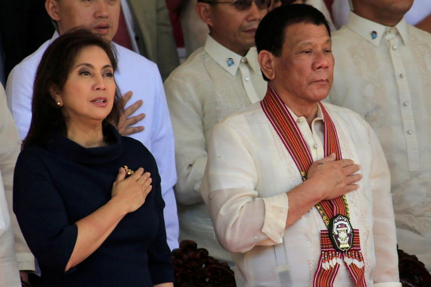 A photo taken on March 24, 2017, shows Philippine President Rodrigo Duterte and Vice-President Leni Robredo during the Philippine National Police Academy graduation ceremony in Cavite city, south of Manila.