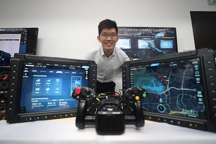 Mr William Peh, programme director at the Defence Science and Technology Agency's Land Systems Programme Centre, in the laboratory where testing is done for the Hunter Armoured Fighting Vehicle's systems. ST PHOTO: TIMOTHY DAVID