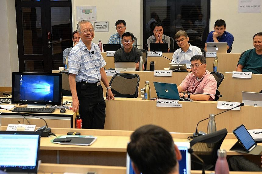 Lee Kuan Yew School of Public Policy professor Lim Siong Guan, former head of the civil service, in a discussion with participants of the Lee Kuan Yew Senior Fellowship in Public Service Programme.