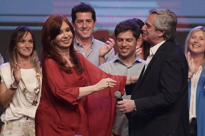Argentina's President-elect Alberto Fernandez with his running mate Cristina Fernandez de Kirchner at their party's headquarters in Buenos Aires on Sunday. Mr Fernandez had been the heavy favourite since winning a landslide victory in the primaries i