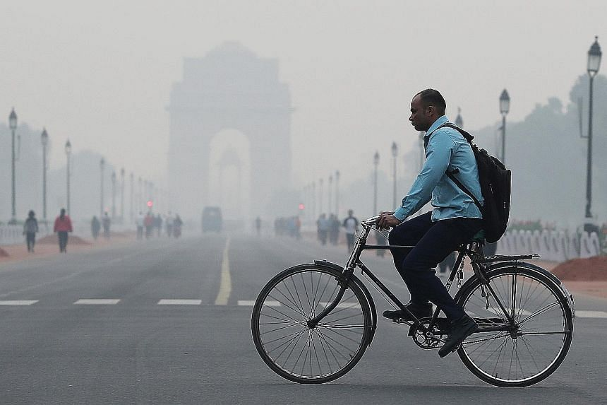 A thick smog yesterday engulfed the Indian capital's landmarks such as the Red Fort and India Gate (above) while drivers experienced visibility problems amid the haze that built up after the Deepavali holiday weekend. Firecrackers and rockets set off