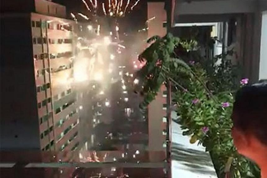 A 23-second video shows fireworks being launched from between two Housing Board blocks in Jurong West Street 73. PHOTO: SG ROAD VIGILANTE/FACEBOOK