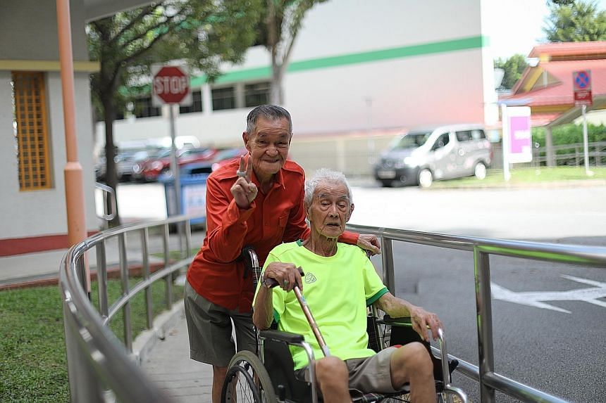 Mr Lee Cho Poon with Mr Neo Cheng Liang, who uses a wheelchair. For years, Mr Lee has opened his heart and home to a few of his fellow seniors, caring for them like they are his family members. His current housemate, Mr Neo, who has dementia and is h