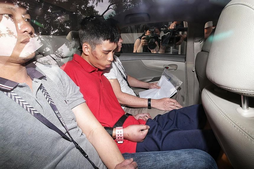 Gabriel Lien Goh arriving at the State Courts yesterday. Cuts and bruises could be seen on his face and arms, and his knuckles were swollen and red. He will be warded for psychiatric observation for three weeks. ST PHOTO: KEVIN LIM