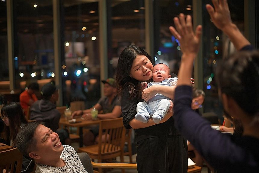 Madam Jaslyn Aw, 42, and her husband Martin Peh, 46, with three-month-old Finn Sage last week. Madam Aw was 39 when the couple decided to turn to science to help her conceive. ST PHOTO: ARIFFIN JAMAR