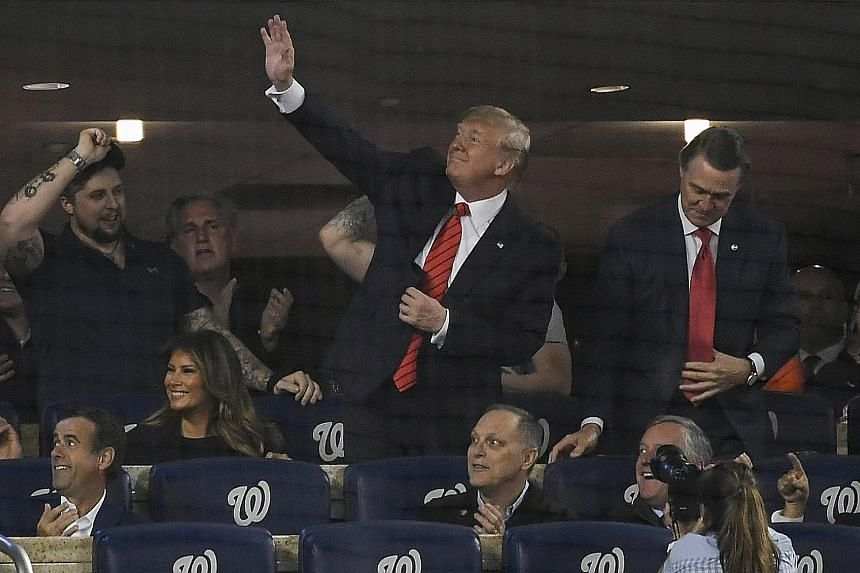 US President Donald Trump at a World Series baseball game in Washington on Sunday. In his presidential address, he described the raid that led to ISIS leader Abu Bakr al-Baghdadi's death in graphic terms.