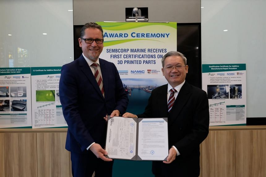 Sembcorp Marine president and CEO Wong Weng Sun (right) receiving the certifications from Mr Remi Eriksen, group president and CEO of DNV GL.