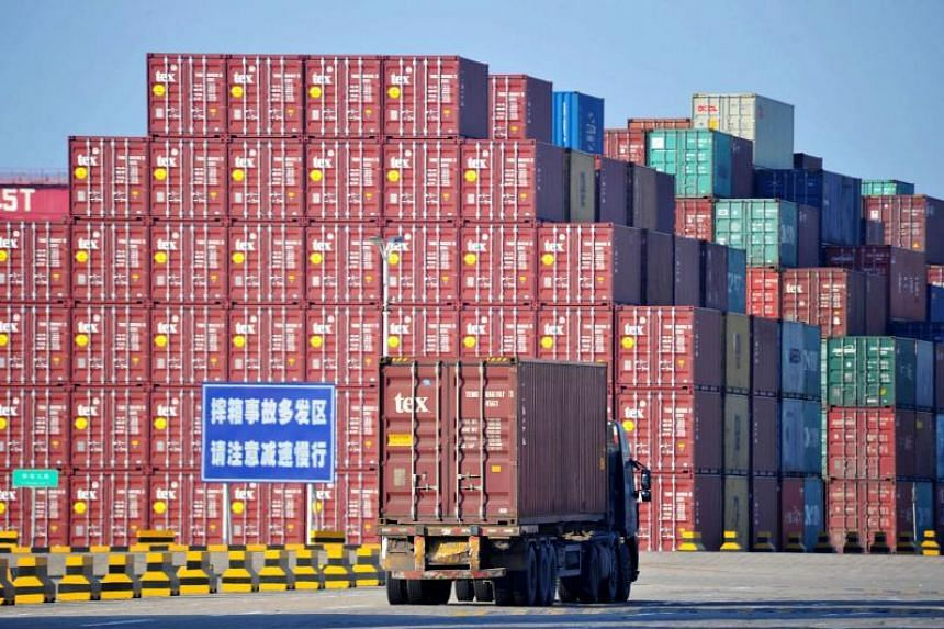 A file photo taken on June 24, 2019 shows containers at the Qingdao Port Foreign Trade Container Terminal in Qingdao, in China's eastern Shandong province.
