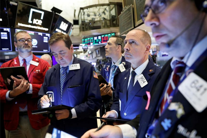 Traders work on the floor at the New York Stock Exchange (NYSE) in New York on Oct 28, 2019.