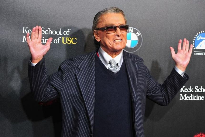 In this file photo taken on March 20, 2014, producer Robert Evans arrives at the 2nd Annual Rebels With A Cause Gala at Paramount Studios in Hollywood, California.