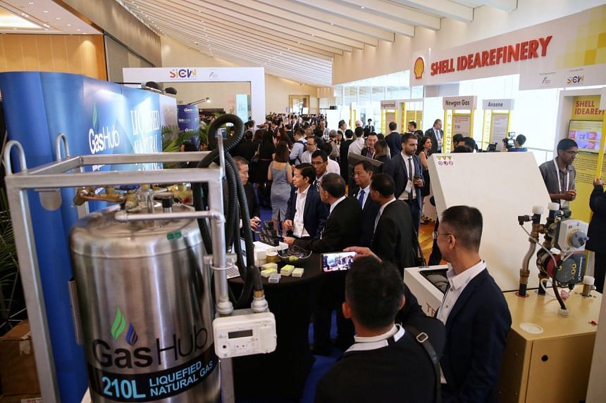 Participants touring booths at the opening of the Singapore International Energy Week, on Oct 29, 2019.