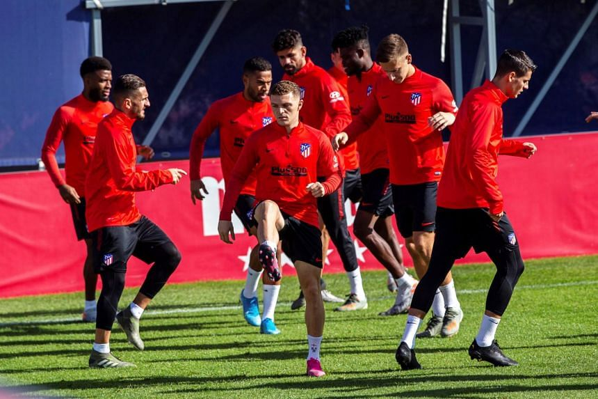 Atletico Madrid's English defender Kieran Trippier (centre) and his teammates attend their training session at Metropolitano Sport Complex in Majadahonda, outside Madrid, Spain, on Oct 28, 2019.