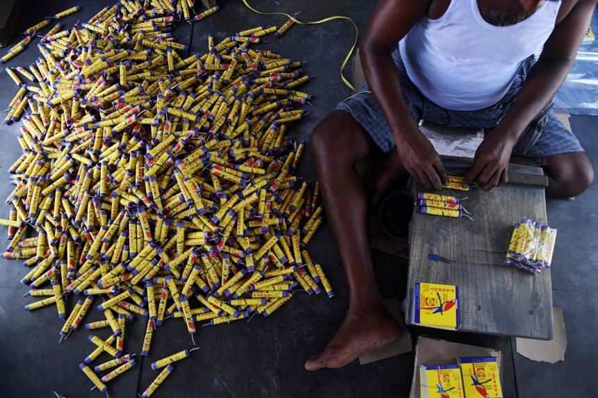 In this photo taken on Oct 14, 2019, a worker produces firecrackers at a manufacturing unit involved in the production of different varieties of firecrackers, in Sivakasi.