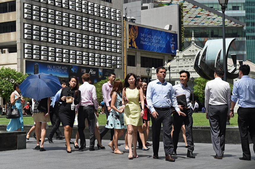 Office workers during lunch time at Raffles Place on June 16, 2014.