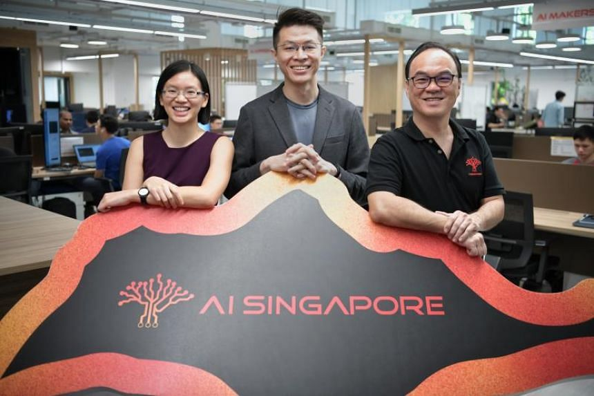 Participants of AI Singapore's full-time apprenticeship programme (from left) Michelle Loke, Lim Tern Poh and Kevin Lee.