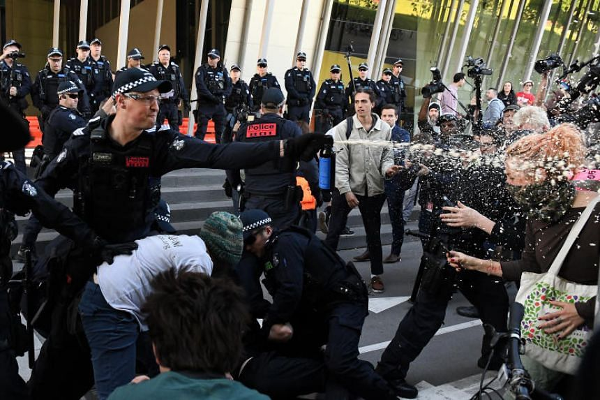 Footage posted on social media showed police using pepper spray and batons to push back protesters from the convention centre hosting the International Mining and Resources Conference.