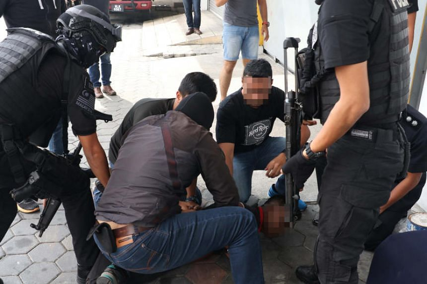 A photo taken on Oct 12 shows Malaysian counter-terrorism police arresting a man said to be a symphatiser of the now-defunct Sri Lankan terrorist group Liberation Tigers of Tamil Eelam.