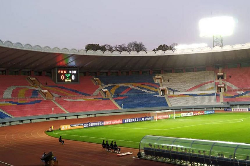 The North's withdrawal comes weeks after Pyongyang hosted a surreal World Cup qualifier in a near-empty stadium (above).