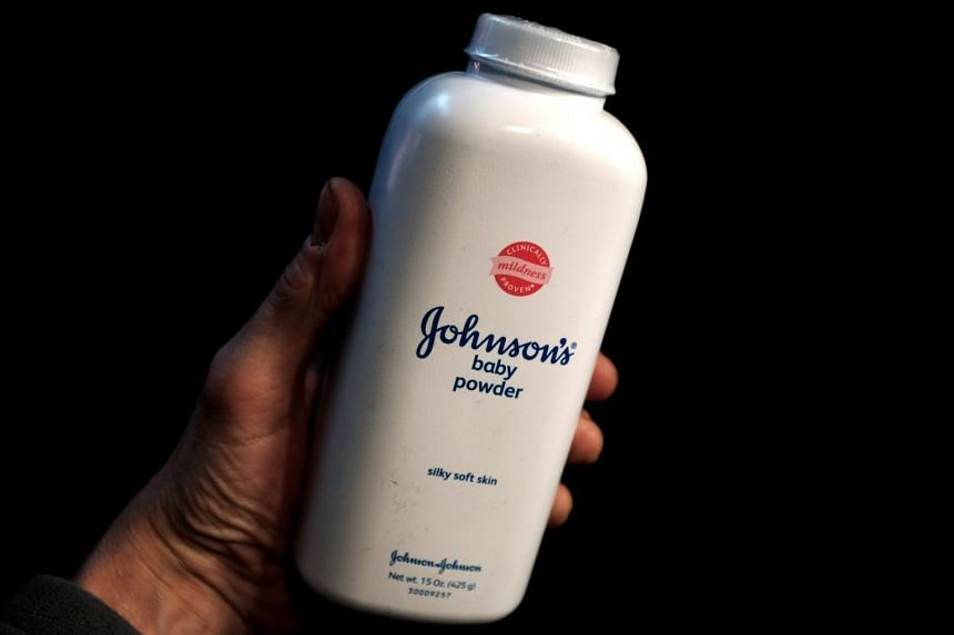 A bottle of Johnson and Johnson Baby Powder is seen in a photo illustration.