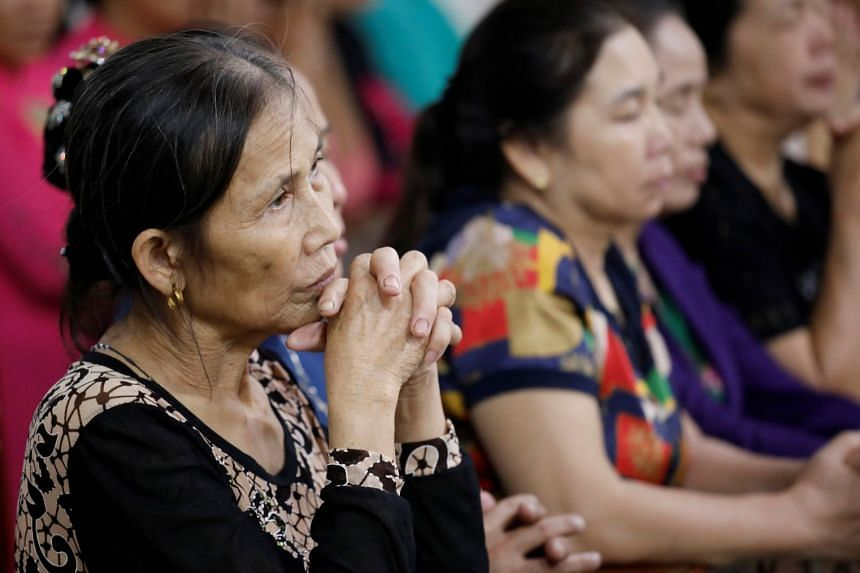 Catholics attend a mass prayer for 39 people found dead in the back of a truck near London, in Nghe An province, Vietnam.