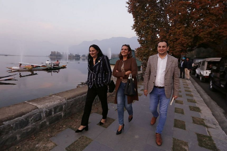 EU lawmakers walk on the banks of Dal Lake in Srinagar.