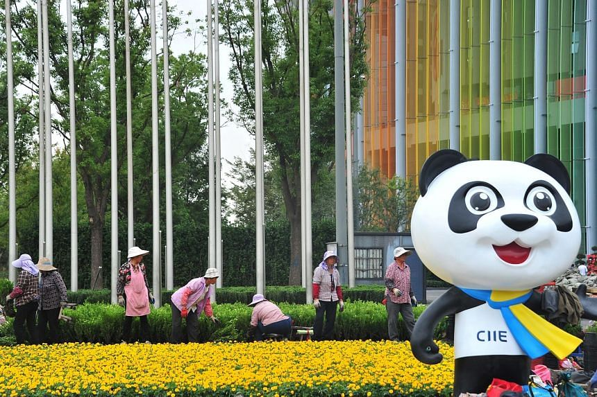 Women working on a garden last week at the venue for the upcoming second China International Import Expo in Shanghai. Chinese officials said this year's fair will be larger than last year's, which attracted over 3,600 companies from 172 countries and
