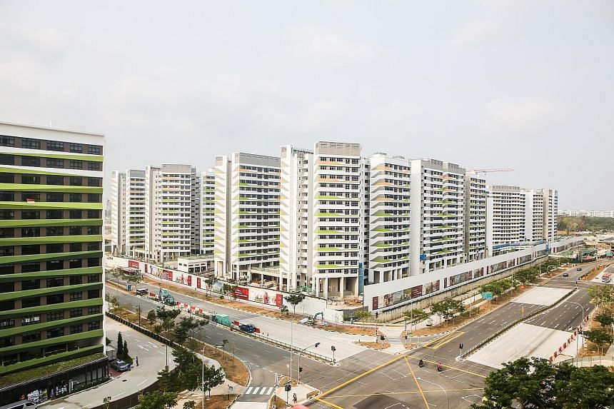 The move to lower the age criterion for Singaporeans with non-citizen spouses could increase demand in the HDB resale market, but purchase prices are not expected to fluctuate widely as a result, said a property analyst. PHOTO: LIANHE ZAOBAO
