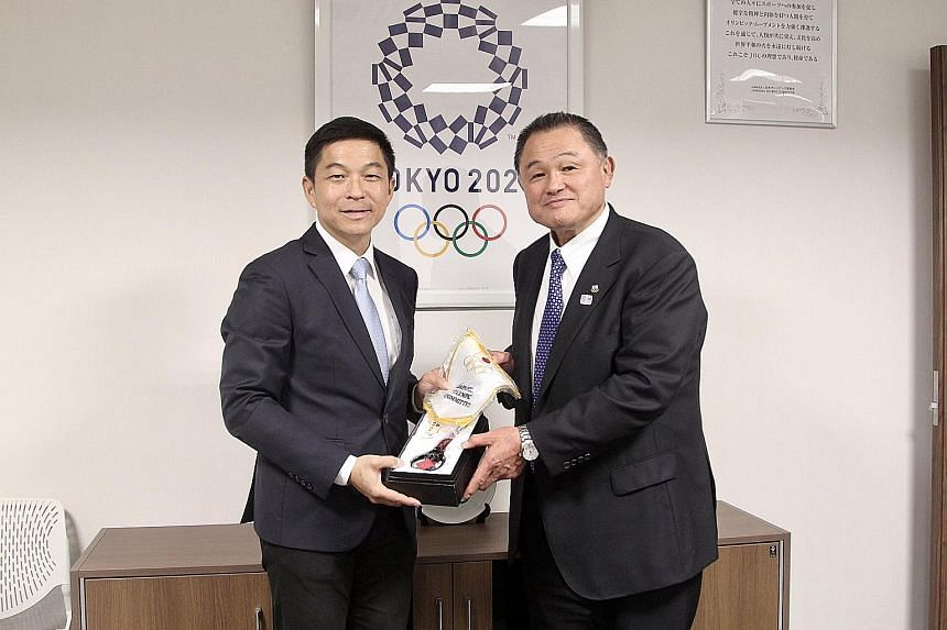 Mr Tan Chuan-Jin, president of the Singapore National Olympic Council, receiving a memento from Yasuhiro Yamashita, president of the Japanese Olympic Committee and Olympic judo open champion at Los Angeles 1984. The Speaker of Parliament led a delega
