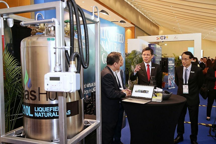 Minister for Trade and Industry Chan Chun Sing at a booth showing the model of a canister used for rebottling liquefied natural gas on Jurong Island yesterday. The model was on display at the Sands Expo and Convention Centre for the Singapore Interna
