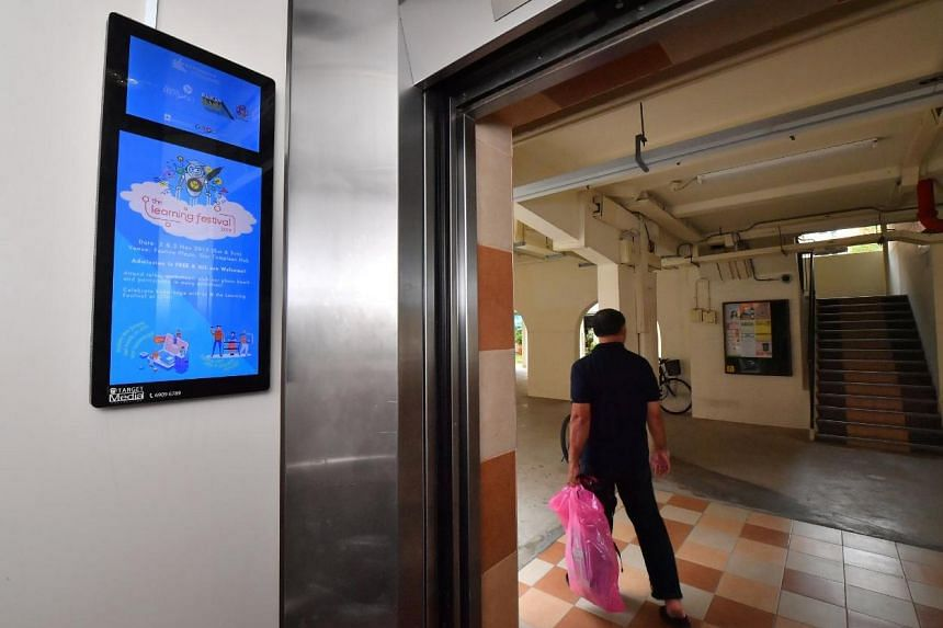 A digital display panel inside the lift of Blk 848 Tampines Street 82 on Oct 30, 2019.