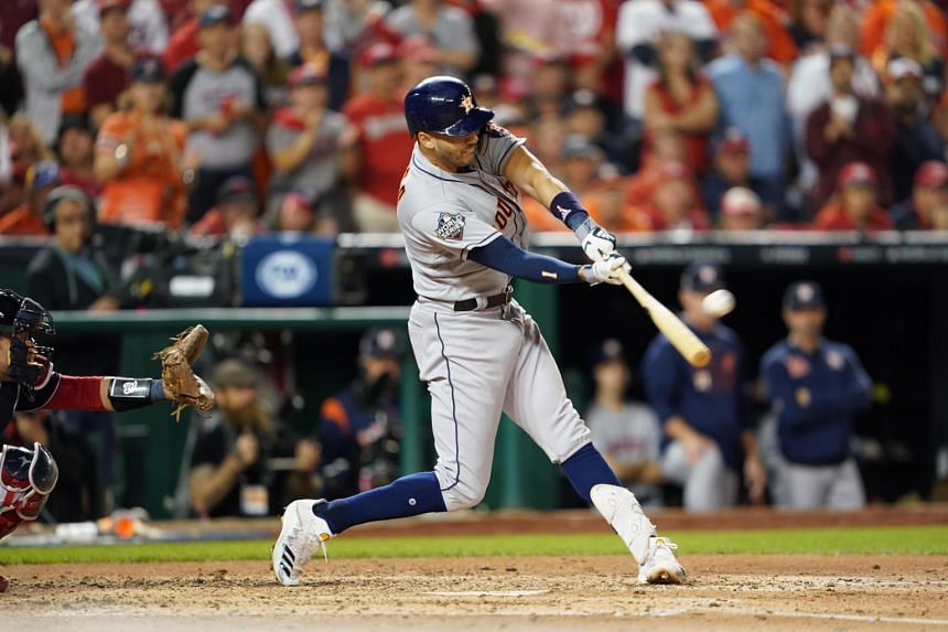 Houston Astros' Carlos Correa connects for a two-run homer in the fourth inning of Game Five of the World Series against the Washington Nationals in Washington on Oct 27, 2019.