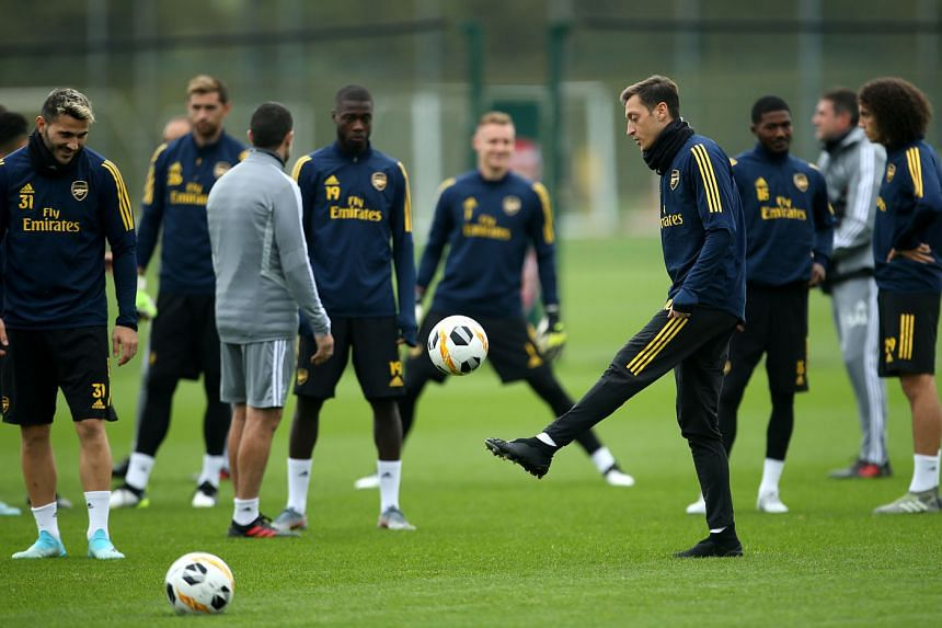 Mesut Ozil juggling the ball as teammate Sead Kolasinac looks on during a training session. The German has barely featured for Arsenal this season, but has been included in the squad to face Liverpool in the League Cup tie.
