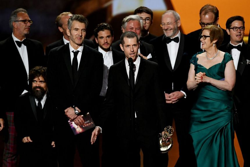 DB Weiss (centre, speaking), David Benioff (third left) and cast and crew of Game Of Thrones accept the Outstanding Drama Series award onstage during the 71st Emmy Awards in September 2019.