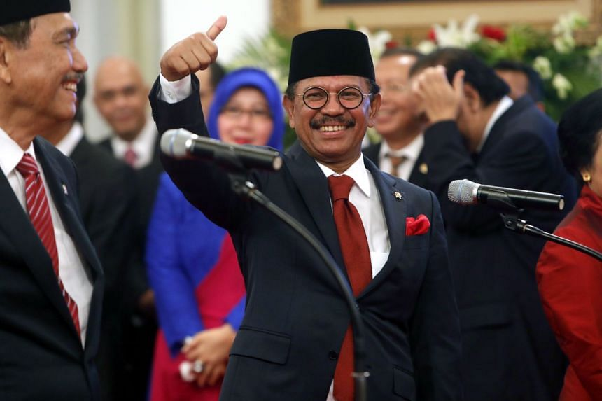 Indonesian youth and sports Minister Zainudin Amali (centre) at the Indonesian cabinet members swearing-in ceremony at Merdeka Palace, in Jakarta on Oct 23, 2019.
