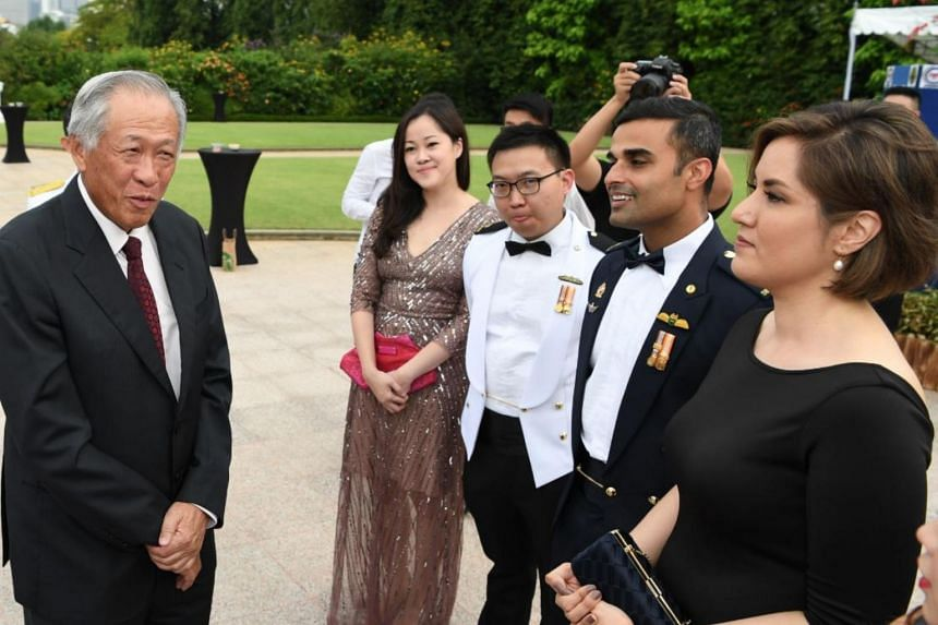Minister for Defence Ng Eng Hen speaks with the top graduates and their spouses at the Goh Keng Swee Command and Staff College Command and Staff Course 2019 Graduation Ceremony and Dinner.