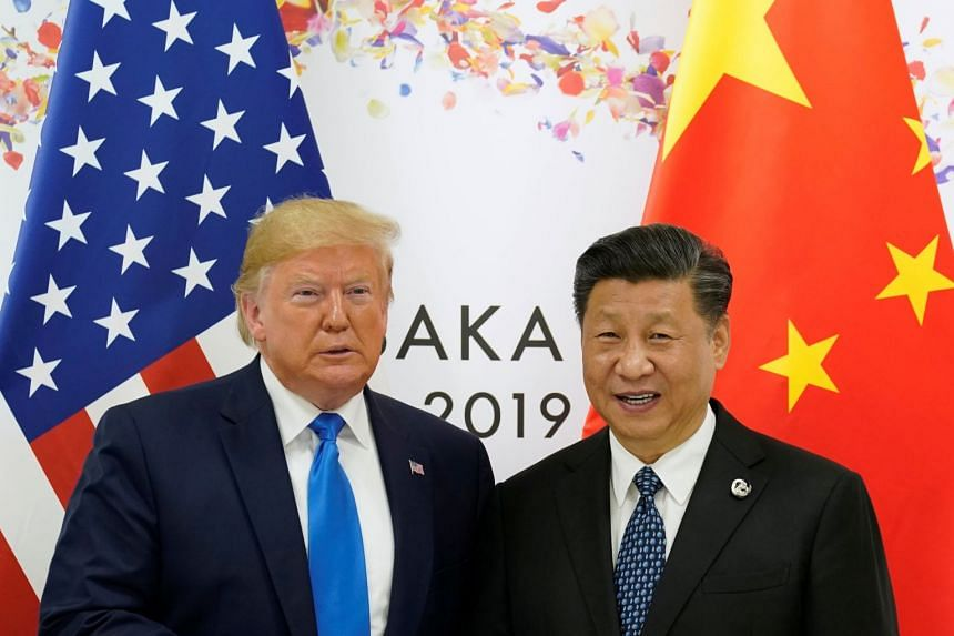 Trump (left) and Xi pose for a photo ahead of their bilateral meeting during the G-20 leaders summit in Osaka, Japan.