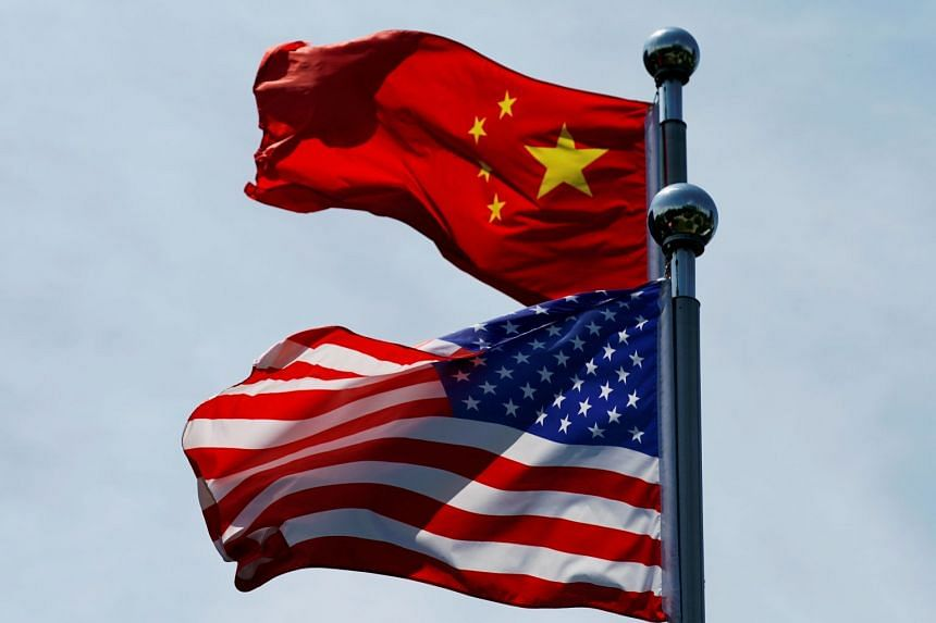 Chinese and US flags flutter before trade talks in Shanghai, in July 2019.